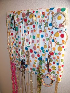 A cheap/fun way of displaying and organizing my jewelry.    I got a little cork board, batting, fabric, and stapled that all together.  Then just used colorful little stick pins to hold the jewelry up.    Works better for me than the jewelry trees & such just because with this I got to choose placement of items so they didn't overlap quite as much.