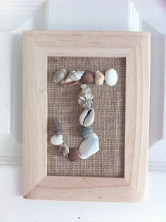 Beach / Ocean theme bedroom. New letter for outside J's bedroom door. Total cost was about $3. :) Cheapo wooden frame, burlap & little shells.