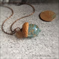 For R for Christmas....Mini Glass Acorn Necklace - Pale Aquamarine with Goldstone Sparkle by Bullseyebeads