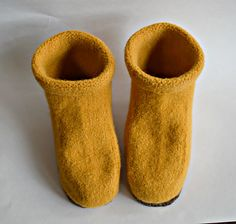 Cozy little booties to keep your feet toasty around the house this winter. A quick knit, they are knit from the sole up and are seamless. The pattern provides instructions for two sizes- one for US Womens Shoe Sizes 5-7.5 and one for US Womens Shoe Sizes 8-10.5. Complete instructions are provided for how to felt the booties in a washing machine.