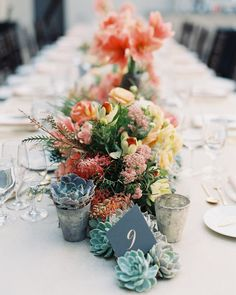 These long tables were decorated with bright arrangements of coral amaryllis…