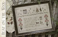 Heap On The Wood.  --This may very well come true as wintery weather is certainly digging in today. This is Brenda's final cross stitch release for the year as she says it's time to move on to cherubs, bunnies and all things Spring-like.