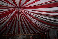 ceiling drape; if this options was allowed at our venue it's a cute way to make it look like we are actually under the big top