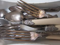 Old silver-plated flatware that you can find cheaply at antique shops and flea markets adds depth to a store-bought set