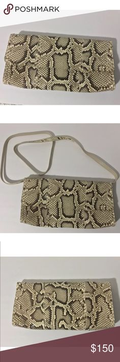 "Carlos Falchi python snakeskin clutch shoulder bag Brand: Carlos Falchi  Python  Leather trim/lining.  Strap snaps on and off  Made in USA  Excellent Condition  I am 100% positive and guarantee that it is authentic  12"" x 6"" x 2""  Strap drop is 23"" carlos falchi Bags Clutches & Wristlets"