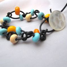 For the love of beads: Easy Peasy Leather and Lampwork Beads Knotted Bracelet Free Tutorial
