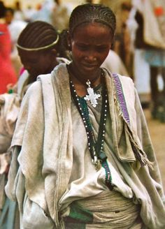 Africa | For over 1600 years Christian Ethiopians have worn neck crosses as a proud confession of their faith. An Amhara woman of Lalibela wears a cross typical of that region hanging on a blue cotton cord called a mateb which she received at baptism. |  © Angela Fisher