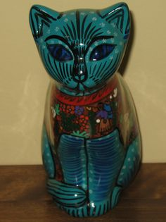 Hand painted green Mexican Ceramic Cat with Wedding scene. THIS ITEM HAS BEEN SOLD but you can click on the picture to find more interesting cats in my eBay store.