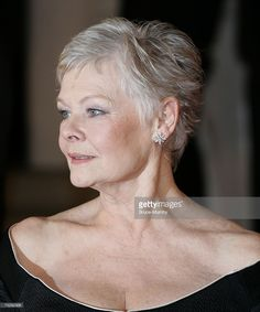 Actress Dame <a gi-track='captionPersonalityLinkClicked' href=/galleries/search?phrase=Judi+Dench&family=editorial&specificpeople=159424 ng-click='$event.stopPropagation()'>Judi Dench</a> arrives at the Orange British Academy Film Awards (BAFTAs) at the Royal Opera House on February 11, 2007 in London, England.