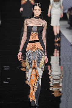 Not sure the sheer top entirely works, but the color/print on the rest of the dress is beautiful.  #Etro #MFW