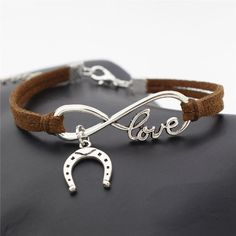 FOR HORSE LOVERS! Show your forever love for horses and wear your lucky horseshoe with a handmade suede Horse Love & Infinity Horseshoe Charm Bracelet. Equestrian Jewelry, Horse Jewelry, Cowgirl Jewelry, Cute Jewelry, Boho Jewelry, Jewelery, Jewelry Accessories, Geek Jewelry, Cheap Jewelry