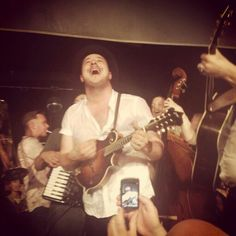 Marcus Mumford. :D and some person taking a picture for the road ;)