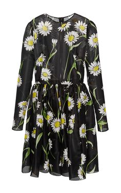 Italy's most renowned design duo use their intricate, finely crafted collections to celebrate a spirited vision of womanhood. This **Dolce & Gabbana** dress features a charming daisy print, an A-line skirt, and a stretch silk lining for comfort and fit.