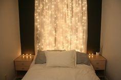 Curtain + Christmas lights = DIY Headboard
