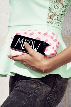This phone case is the cat's meow. Styled with mint peplum top and lip print makeup bag. │ H&M Divided