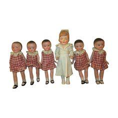Miniature vintage Dionne Quints dolls with Their Nurse