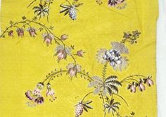 Spitalfields silk w/ floral taffeta by Anna Maria Garthwaite. Yellow silk is brocaded w/ colored silks, silver & silver gilt thread. Her skill in rendering botanical subjects is in evidence in the floral sprays. Image reproduced from the Grantham Times, 4 May 2013.