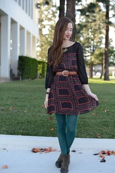 Wearing teal tights with dark colours printed dress