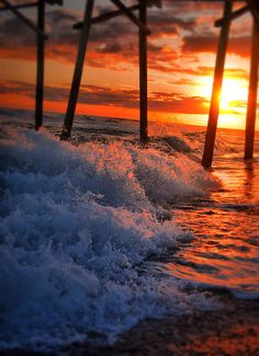 ✮ A gorgeous sunset over Emerald Isle with the pink in the ocean splash