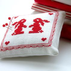 two bunnies - redwork cross stitch pincushion by Bela Stitches, via Flickr