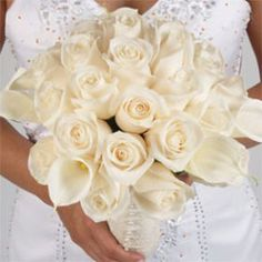"""<p>This beautiful and elegant bridal bouquet has 26 stems of ivory roses and 7 calla lilies. The bridal bouquet is 18"""" long. The stems are wrapped with ribbon. In all wedding/or special occasion flowers we recommend your delivery date to be two or three days before your event and to order at least 10 days before the delivery date. Your wedding flowers and wedding roses are shipped absolutely fresh, direct from the greenhouses to you via FedEx.</p>"""