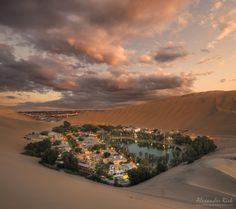 """Enjoy the Silence - The Oasis of Huacachina surrounded by huge sand dunes in the Southwest of Peru. Feel free to follow me on <a href=""""https://www.facebook.com/pages/Alexander-Riek-Photography/588013561261816"""">FACEBOOK</a> or to visit my <a href=""""http://www.photographichorizons.com"""">WEBSITE</a>"""