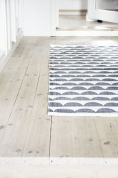 This scalloped rug is lovely.