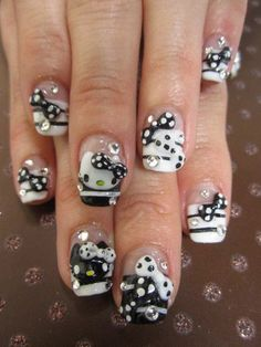Rock your outfit with this stunning black and white themed Hello Kitty nails! Backed with black and white stripes and topped with cute Hello Kitty faces and polka dot bows. If you want to stand out and make a statement then this is the nail art to go!