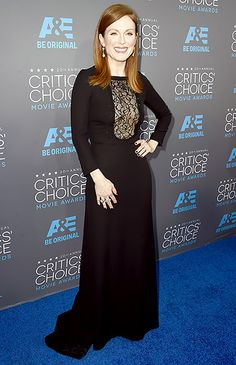 Julianne Moore flaunted her cleavage via a lace panel on the bodice of her long-sleeved black gown.