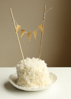 Mini bunting idea for cupcakes (these instrutions use metal flags but you could just cut them out of paper)