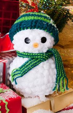 I'm not a crocheter but why not use foam balls, some white pom poms and decorate one??? so cute!