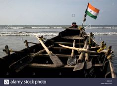 Indian flag attached with a fishing boat in the beach of Digha, West Bengal, India