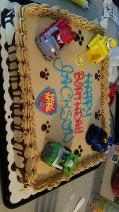 Paw patrol cake Chocolate cake with peanut butter frosting, chocolate ganache and buttercream writing