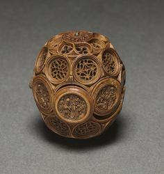"c. 1500-1530 Carved boxwood paternoster bead, South Netherlands (2 1/4 x 1 7/8 in.) ""Prayer nuts or ""paternosters"" are generally made from boxwood and carved with extreme refinement and delicacy with openwork Gothic tracery. They came into fashion as private devotional accessories in the Netherlands in about 1500 to 1530. About 50 prayer nuts are still known to survive."" Cleveland Museum of Art 1961.87"
