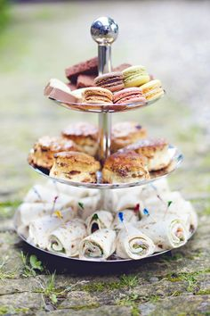 High tea with scones, macarons and wraps.