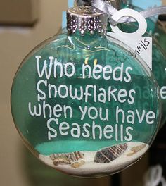Something completely different from Happy Trails! A lovely glass disc ornament for the Christmas tree decorated with the phrase Who Needs Snowflakes when you have Seashells on a thin piece of acetate contained inside the glass ball. Also, inside the ball is beach sand and at least