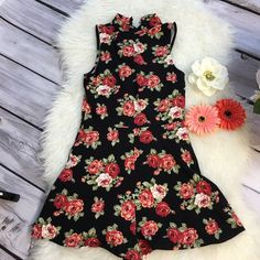 """FLORAL ROMPER Cotton blend floral mini romper. Small mock turtleneck with 2 button closure. Backside has short opening. Worn 1x and in good condition like new! Fits xs and small. Measures 28"""" from shoulder to bottom. Forever 21 Shorts"""