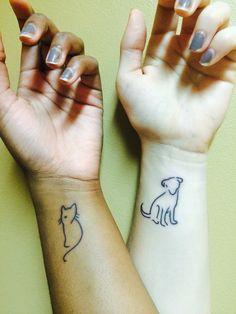 Mine and my girlfriend's simple animal tribute tattoos! We were so in love with the designs; and yes, we are pet lovers