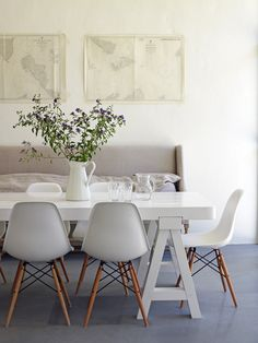 A calming dining room with neutral colors and classic Eames chairs.