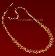 Very simple and attractive ruby necklace in 22 carat gold with a 4 stone design running around the neckline. This lightweight ruby necklace is suitable on salwar and sarees alike.