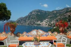 I have never seen in person or in pictures anywhere orange seat cushions!  I don't think this color works with the painted tiles do you? The yellow cushions are perfect.  Positano, Italy - IL San Pietro Hotel