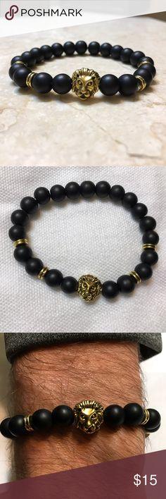 Unisex Gold tone lion head black bead bracelet Antique Gold Tone Lion Head Bracelet Smooth Black Stone Beaded Bracelet.  I will always ship same day! One size fits all stretch elastic. Accessories Jewelry