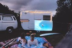 Moonlit Cinema - the Caravan features a projector with 70's surf…
