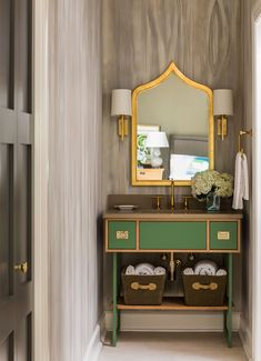 Loved using this campaign chest-like cabinet for the bathroom - Tobi Fairley Interior Design