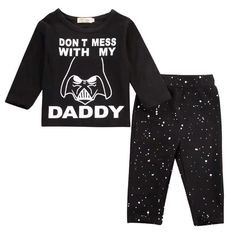 """""""Don't Mess with My Daddy"""" The force is strong with this little one.. Long sleeves shirts and pants set, coming to your galaxy this summer . . . #thetotdrawer #baby #babyboy #babygirl #babyfashion #toddler #toddlerfashion #kidstyle #kidswear #kidsfashion #childrenswear #set #blackandwhite #starwars #darthvader #daddysboy #daddysgirl #force"""