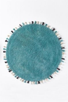 CUTE BATH MAT, THOUGH WON'T HAVE USE FOR IT IN FIRST YEAR  mt round tassle bath mat