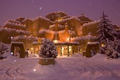 A snow topped Inn at Loretto decorated for Christmas in Santa Fe, New Mexico.