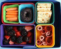 Ham, carrots, crackers and berries bento.