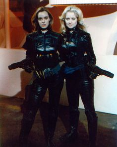 "Anne Lockhart as Lieutenant Sheba and Laurette Spang as Cassiopeia - two major female characters with no counterparts in the 2004 series - pose in their awesome assault team bondage wear from the 1978 episode ""The Living Legend."""
