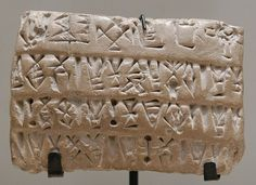 Economic tablet with numeric signs. Proto-Elamite script in clay, Susa, Uruk period (3200 BC to 2700 BC). Department of Oriental Antiquities, Louvre. - Wikipedia, the free encyclopedia